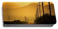Portable Battery Charger featuring the photograph The Golden Road by Matt Harang