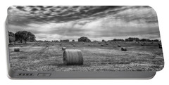 Portable Battery Charger featuring the photograph The Hay Bails by Howard Salmon