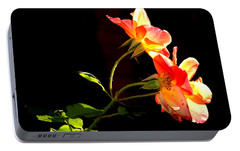 Portable Battery Charger featuring the photograph The Illuminated Rose by AJ  Schibig