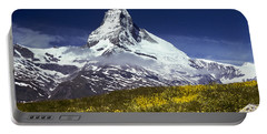 Portable Battery Charger featuring the photograph The Matterhorn With Alpine Meadow In Foreground by Jeff Goulden