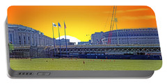 The Old And New Yankee Stadiums Side By Side At Sunset Portable Battery Charger