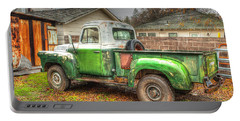 Portable Battery Charger featuring the photograph The Old Green Truck by Jim Thompson