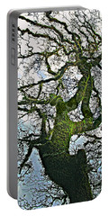 The Old Mossy Oak Tree Against Cloudy Sky Portable Battery Charger