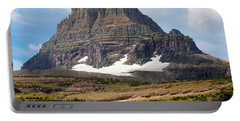 Portable Battery Charger featuring the photograph The Peak At Logans Pass by John M Bailey