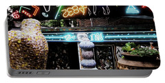 Portable Battery Charger featuring the photograph The Venice Cafe' Outdoor Garden by Kelly Awad