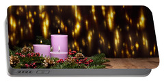 Three Candles In An Advent Flower Arrangement Portable Battery Charger