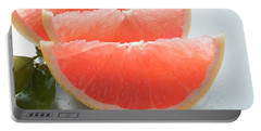Three Pink Grapefruit Wedges, Leaves Beside Them Portable Battery Charger