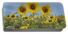 Three Sunflowers At The Front Of A Sunflower Field Portable Battery Charger