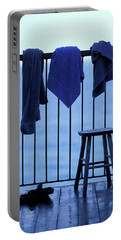 Three Towels Hanging On A Railing Portable Battery Charger