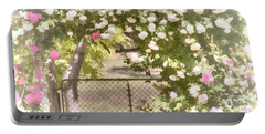 Portable Battery Charger featuring the photograph Through The Rose Arbor by Elaine Teague