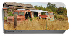 Portable Battery Charger featuring the photograph To Everything There Is A Season. Rusty Old Trucks And A Barn by Connie Fox