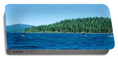 Tourists Paddle Boarding In A Lake Portable Battery Charger