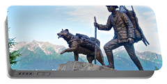 Trail Blazers Sculpture For 2012 Iditarod Beginning At Mile 0 In Seward-ak Portable Battery Charger