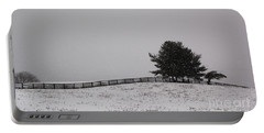 Tree And Fence In Snow Storm Portable Battery Charger