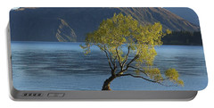 Tree In Lake Wanaka Portable Battery Charger by Stuart Litoff