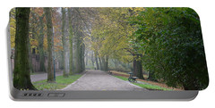 Portable Battery Charger featuring the photograph Tree Lined Path In Fall Season Bruges Belgium by Imran Ahmed