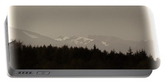 Treeline With Ice Capped Mountains In The Scottish Highlands Portable Battery Charger