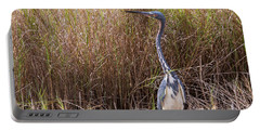 Portable Battery Charger featuring the photograph Tricolored Heron Peeping Over The Rushes by John M Bailey
