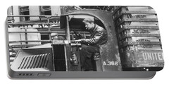 Truck Driver In His Cab Portable Battery Charger by Underwood Archives