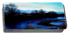 Portable Battery Charger featuring the photograph Truckee River In Motion by Bobbee Rickard
