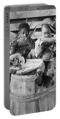 Two Boys Eating Watermelon Portable Battery Charger by Underwood Archives