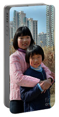 Two Chinese Teen Sisters Hug  And Embrace Shanghai China Portable Battery Charger