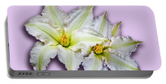 Two Clematis Flowers On Pale Purple Portable Battery Charger