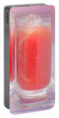 Two Glasses Of Pink Grapefruit Juice With Ice Cubes Portable Battery Charger