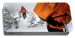 Two Men Hiking In The Snow On Mt Portable Battery Charger