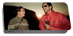 Two Men Share Stories As The Sun Sets Portable Battery Charger
