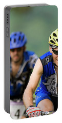 Two Mountain Bike Racers Ride Portable Battery Charger