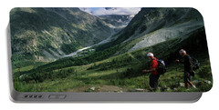 Two Older Males Hiking The Swiss Haute Portable Battery Charger