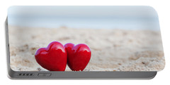 Two Red Hearts On The Beach Symbolizing Love Portable Battery Charger