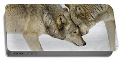 Two Wolves In  A Staredown Portable Battery Charger by Gary Slawsky