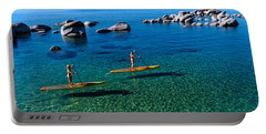 Two Women Paddle Boarding In A Lake Portable Battery Charger