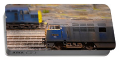Portable Battery Charger featuring the photograph Two Yellow Blue British Rail Model Railway Train Engines by Imran Ahmed