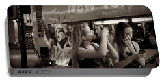 Portable Battery Charger featuring the photograph Girls With Phones And Tourbus - Times Square by Miriam Danar