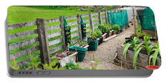Vegetable Garden Portable Battery Charger by Tom Gowanlock