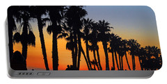 Portable Battery Charger featuring the photograph Ventura Boardwalk Silhouettes by Lynn Bauer