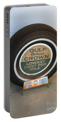 Portable Battery Charger featuring the photograph Vintage Gulf Tire With Ad Plate by Lesa Fine