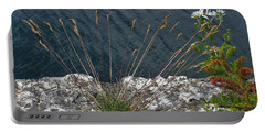 Portable Battery Charger featuring the photograph Flowers In Rock by Brenda Brown