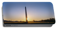 Washington Monument At Sunrise Portable Battery Charger by Panoramic Images
