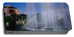 Water Fountain With A Rainbow In Front Portable Battery Charger