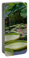 Portable Battery Charger featuring the photograph Water Lilies And Platters And Lotus Leaves by Byron Varvarigos