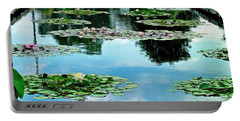 Water Lily Garden Portable Battery Charger by Zafer Gurel