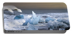 Portable Battery Charger featuring the photograph Water Versus Ice by Gunnar Orn Arnason