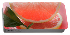 Wedge Of Pink Grapefruit On Slice Of Grapefruit With Leaf Portable Battery Charger