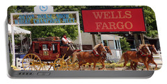 Portable Battery Charger featuring the photograph Wells Fargo At Devon by Alice Gipson