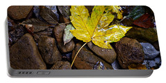 Wet Autumn Leaf On Stones Portable Battery Charger