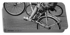 Portable Battery Charger featuring the photograph Wheelie Boys by Ari Salmela